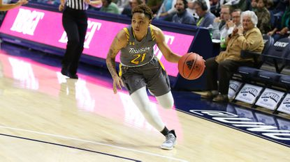 Towson's Kionna Jeter dribbles the ball during a game against Temple on Dec. 4, 2019.