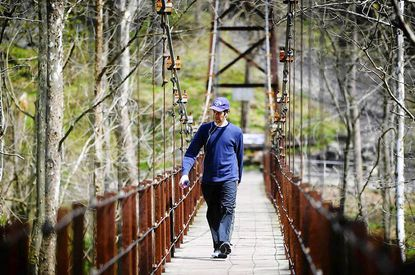 Geoff Phillips of Elkridge walks across a bridge in the Avalon area of Patapsco State Park, which is one of several Howard County tourist destinations.