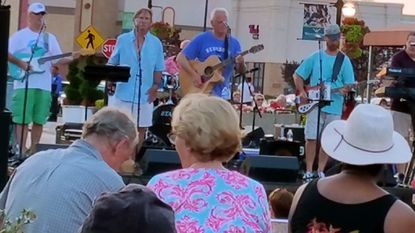 The community gathered at Waugh Chapel Town Centre Saturday to enjoy a free concert by the band A Classic Case. The Town Centre will be holding free concerts every Saturday night 7-8:30 p.m. throughout July and August.