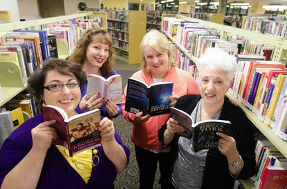 Once a month, the Arbutus Library is the site for a meeting of the Maryland Romance Writers. From left, Stephanie Draven, of Owings Mills, Christi Barth, of Baltimore, Joya Fields, of Catonsville, and Rebecca York, of Columbia, are among the members who have had their novels published.