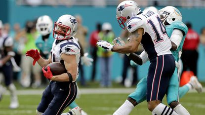 Patriots receiver Michael Floyd (14) delivers a key block downfield to spring teammate Julian Edelman on a 77-yard touchdown pass play during the third quarter Sunday.