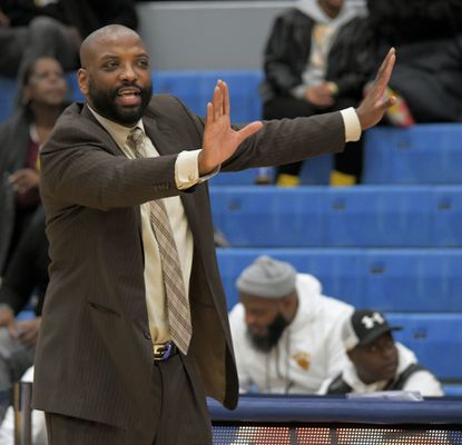 Dunbar coach Keith Booth directs his team during the 2020 Basketball Academy tournament at Morgan State on Jan. 10, 2020.