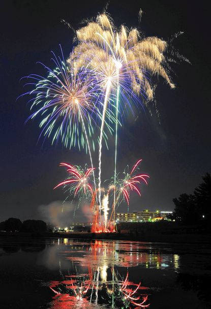 Fireworks light up the night sky during the Fourth of July Celebration at the Carroll County Farm Museum July 4, 2012.