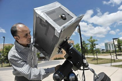 """Sanjit Karmakar, a post-doctoral physics fellow at UMBC, is doing research in """"ghost imaging"""" using a quantum camera and sunlight ."""
