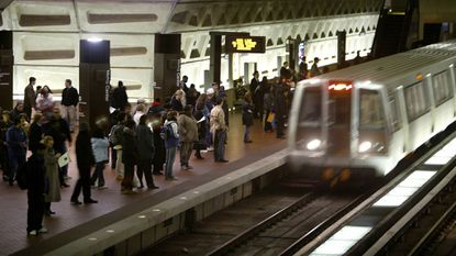 In a file photo, riders wait to board an arriving train at the D.C. Metro Center, in Washington. Metro's largest union has overwhelmingly authorized a potential transit system strike, just as thousands of tourists arrive in the nation's capital for MLB All-Star Week.