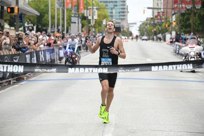 Jeremy Ardanuy crosses the finish line of the marathon portion of the Baltimore Running Festival on Sat. Oct. 9, 2021, winning with a time of 2:26:49.