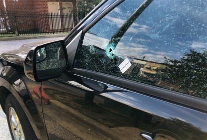 A resident's car parked on Clay Street was struck by a stray bullet. Police say a disagreement at a party resulted in the early Sunday morning shooting that killed a Baltimore man.
