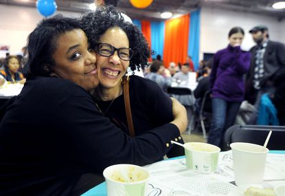Left to right, Courtney Dorsey hugs her aunt, Sandra Spencer, both of Baltimore, at the Empty Bowls event, the eighth annual fundraiser for the charitable work of St. Vincent de Paul of Baltimore.