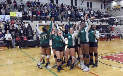 Atholton players wave to their fans after defeating Bel Air during the Class 3A state championship volleyball match at University of Maryland's Ritchie Coliseum on Tuesday, Nov. 20.