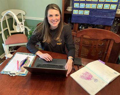 Harford Tech High School teacher Elizabeth White was recently named the 2020-2021 Harford County Teacher of the Year. Here, White prepares a lesson to be recorded at her home and posted on the school system website for students to access.