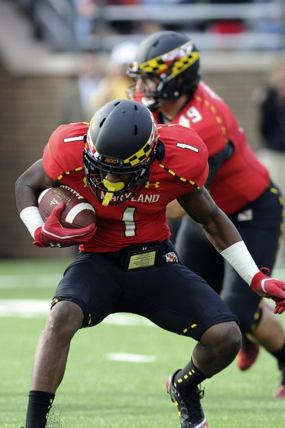 Terps wide receiver Stefon Diggs runs with the ball in the second half against Boston College.