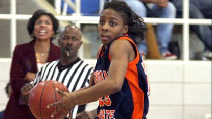 Tamara Moore, who played as Tamara Rogers, drives to the basket for Morgan State in 2008. Moore founded the Baltimore Cougars Legends program in 2013 to help recent college graduates play pro basketball.