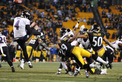 The Pittsburgh Steelers block a punt by Ravens punter Sam Koch following Patrick Scales' high snap.