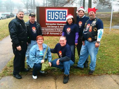 Laurel Police Pfc. Mark Schmidt (far left) helped members of Laurel Moose Lodge and the Laurel Moose Riders deliver toys to Fort Meade, including, left to right, Dale Coyle, Jean Gaverth, Chris Davis, Ing Johnson, Ed Dunn and Shane Cooper.