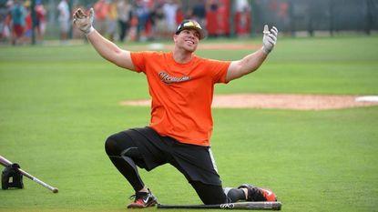 Chris Davis having some fun with teammates during practice at the Ed Smith Stadium complex in Sarasota, Florida.