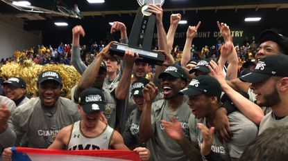 UMBC celebrates beating Vermont for the America East championship and an NCAA tournament berth in Burlington, Vt., on Saturday, March 10, 2018.