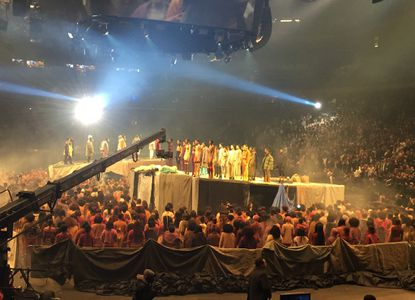 "Models stand on stage as Kanye West presents his Yeezy collection at Madison Square Garden during Fashion Week, Thursday, Feb. 11, 2016, in New York. West played songs from his latest album, ""The Life of Pablo,"" out on Friday, and streamed it to audiences in movie theatres across the globe, including Charles Theatre in Baltimore."