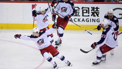 Blue Jackets left wing Artemi Panarin, front, celebrates his game-winning goal during overtime in Game 1 of a first-round playoff series against the Capitals, Thursday, April 12, 2018, in Washington.