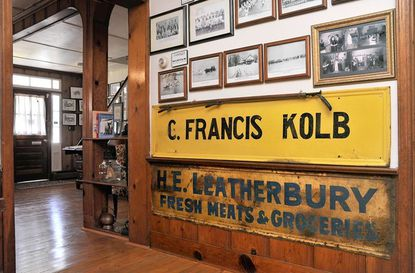 The wooden signs from two of Galesville's general stores, Kolb's and Leatherbury's, are on display at The Galesville Heritage Society, which wants to highlight the history of the West River town's Main Street stores.