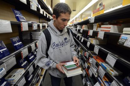 UC Berkeley junior and integrated biology major Steven Ilko shops for textbooks at the student store in Berkeley, Calif., Jan. 27, 2014.
