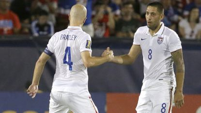 U.S. forward Clint Dempsey (8) shakes hands with team captain Michael Bradley during a CONCACAF Gold Cup soccer match in Frisco, Texas, Tuesday, July 7, 2015.