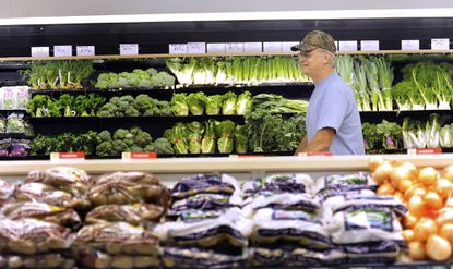 Bruce Merriman, of Overlea, scans the produce section at Fresh & Green's grocery store in Parkville Shopping Center in 2011.
