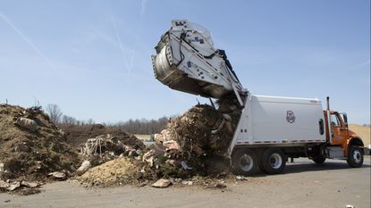 A truck dumps off yard trim and branches for composting at Alpha Ridge Landfill in Marriottsville.