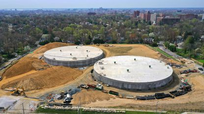 A pair of 6.8 million gallon concrete water tanks near completion where the Guilford Reservoir once stood in North Baltimore.