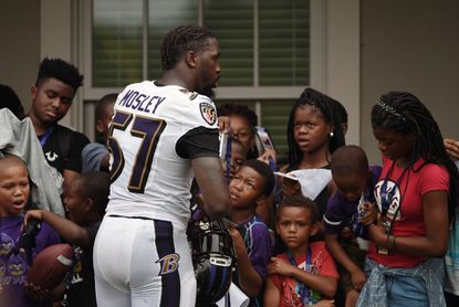 Ravens inside linebacker C.J. Mosley signs autographs for fans after practice on the second day of training camp at the Under Armour Performance Center.
