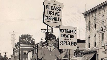 "Around 1950, a sign character we called ""Sammy Safety,"" appeared at the corner of Liberty Street and West Main Street at the railroad tracks. The sign proudly proclaims ""No traffic deaths since Sept. 3, 1949."""