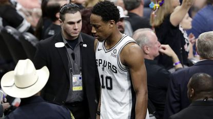 Spurs guard DeMar DeRozan leaves the court after he was ejected from Game 4 against the Nuggets on Saturday.