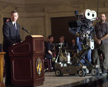 """Then-Mayor Martin O'Malley takes part in the filming of """"Ladder 49"""" at the War Memorial Plaza in 2003."""