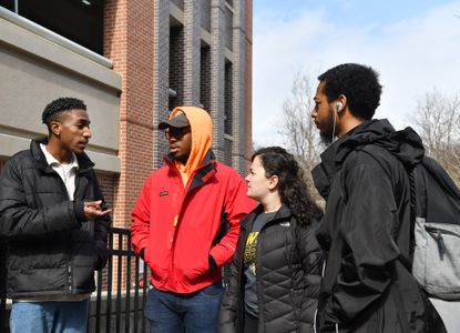 Towson University students , from left, Jordan Smith, Delano Powell, Sarah Fishkind and Maurice Ratliff III are organizing on Towson University campus to get the names changed on two dorms, Paca House and Carroll Hall, because they are named after Marylanders who owned slaves.