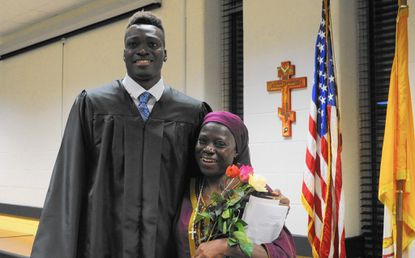 Mike Tertsea, a John Carroll senior from Nigeria, was surprised to learn his class pitched in to help bring his mother, Felicia Ikpum, in for his graduation after being apart for four years.