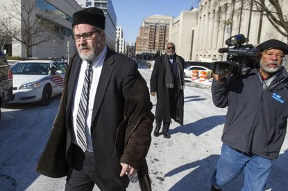 Rabbi Barry Freundel leaves the D.C. Superior Court House in Washington after pleading guilty to videotaping women at a Jewish ritual bath.