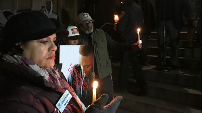 Baltimoreans condemn the city's violence at a Thursday night vigil for Jacquelyn Smith, 54, who was fatally stabbed early Saturday morning while giving money to a panhandler.