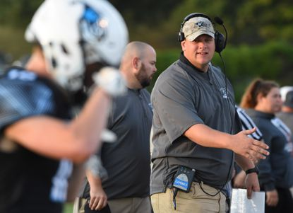 Westminster football head coach Chris Bassler walks the sidelines during a game against South River at Westminster High School on Friday, September 6.