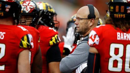 Maryland interim coach Matt Canada speaks with players during a timeout in the first half of the team's 63-33 win over Illinois Oct. 27 in College Park.