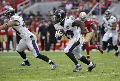 Ravens running back Justin Forsett (29) runs against the San Francisco 49ers.
