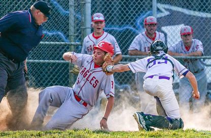 Centennial's Dylan Watson slides safely into home past Long Reach catcher Conner Bosley during a baseball game at Long Reach on May 27, 2021.
