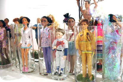 """Still being completed, these are some of the dolls Diana Marta gathered for her installation titled """"A New Playing Field"""" for the resident artists exhibit at Howard County Art Center."""