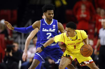 Maryland guard Anthony Cowan Jr., right, drives against Seton Hall guard Anthony Nelson in the first half of an NCAA college basketball game, Saturday, Dec. 22, 2018, in College Park, Md. (AP Photo/Patrick Semansky)