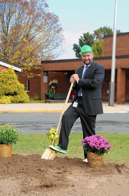 Principal Thomas Smith holds his ceremonial shovel as he poses for a photo after breaking ground for construction of the new Youth's Benefit Elementary School Tuesday morning.