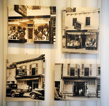 Old photos showing the Getz family store in Bel Air hang on display in the Bel Air lobby of Getz Law Office.