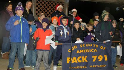Members of Cub Scout Pack 791 sing at a tree lighting ceremony in Hampstead in 2015. The pack is holding a flapjacks fundraisers at Applebee's in Westminster on Saturday, Feb. 9.