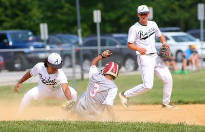 Atholton's Diego Carrion, left, applies the tag during a baseball game against Oakland Mills on Thursday, June 3, 2021.