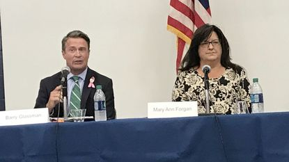 Republican County Executive Barry Glassman, left, and his Democratic election opponent, Maryann Forgan participate in a candidate forum at Harford Community College.