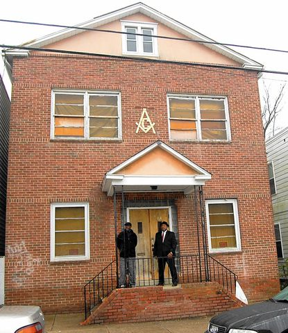 Gregory Williams and Jeffrey stand outside Universal Lodge No. 14 of Free and Accepted Masons, a Clay Street building listed on the National Register of Historic Places. A $200,000 grant was recently secured to repair the exterior of the more than century-old building.