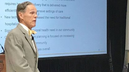 Lyle Sheldon, president and CEO of University of Maryland Upper Chesapeake Health, discusses plans to consolidate services and open a medical center in Aberdeen during a public meeting Thursday at the Aberdeen Fire Hall.