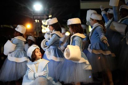 Ella Reiner, left, 7, of Towson, dances with Anna Apicella School of Dance during the Baltimore County Christmas tree lighting ceremony, held Dec. 1 at Olympic Park in downtown Towson.